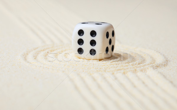Dice on sand in rock garden Stock photo © pzaxe