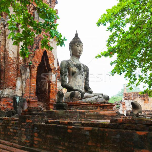 Anciens pierre statue buddha ruines bouddhique Photo stock © pzaxe