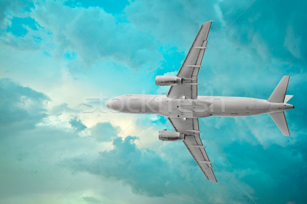 Passenger airplane in the beautiful cumulus clouds Stock photo © pzaxe