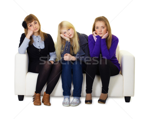 Genç kızlar üzücü oturma kanepe üç Stok fotoğraf © pzaxe
