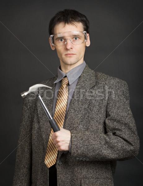 Homem óculos de proteção prontidão martelo moço fundo Foto stock © pzaxe