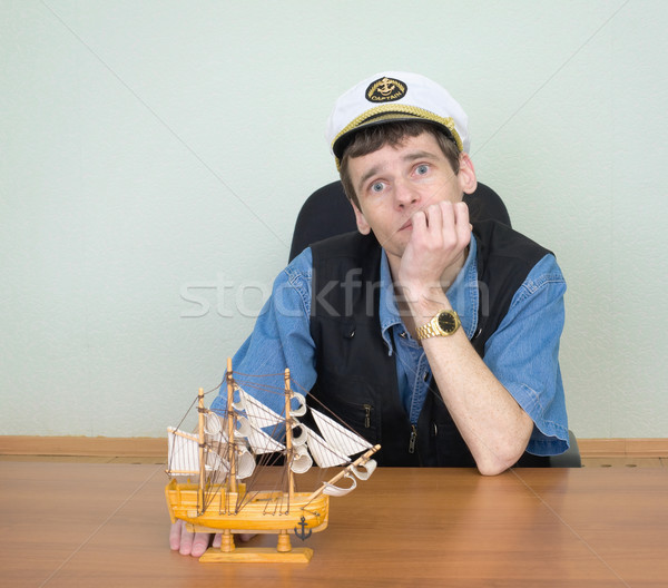 Man with model of a sailing vessel Stock photo © pzaxe