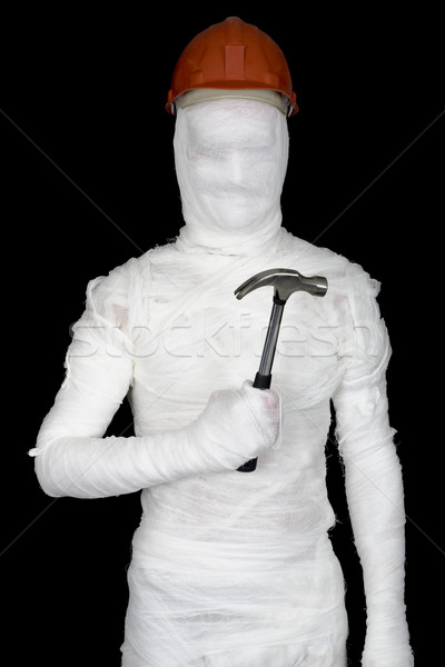 Laborer in bandages with helmet and hammer Stock photo © pzaxe