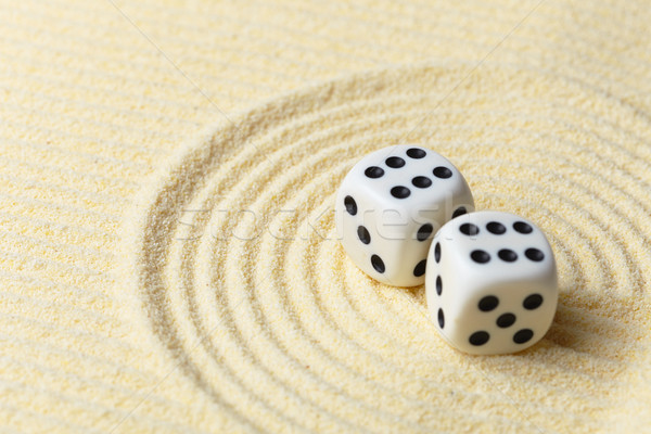 Dices on sand surface - abstract art composition Stock photo © pzaxe