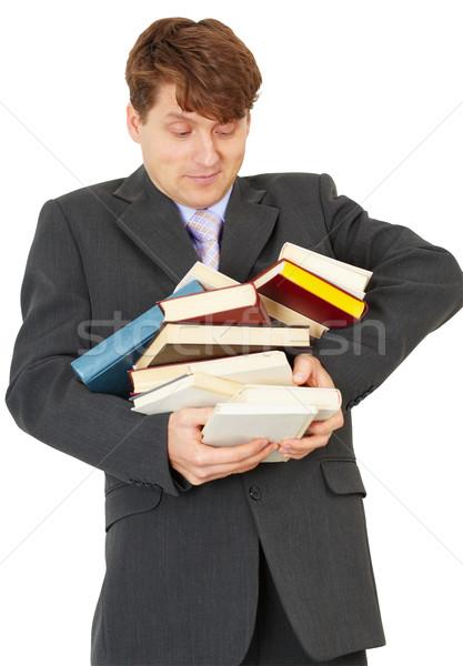 Mann Studenten halten Heap Pfund Lehrbücher Stock foto © pzaxe