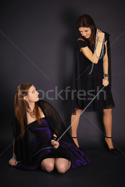 Two young girls playing master and slave Stock photo © pzaxe