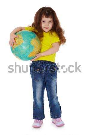 Petite fille jeans géographique monde isolé Photo stock © pzaxe