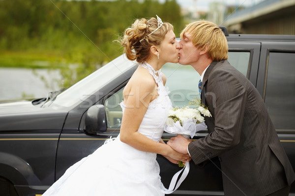 Bride and groom kissing near a car Stock photo © pzaxe