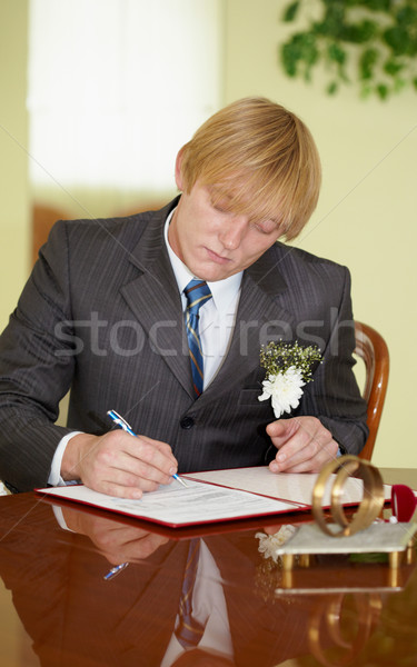 Groom solemnly signed documents Stock photo © pzaxe