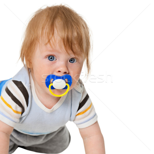 Attentive baby with a pacifier Stock photo © pzaxe