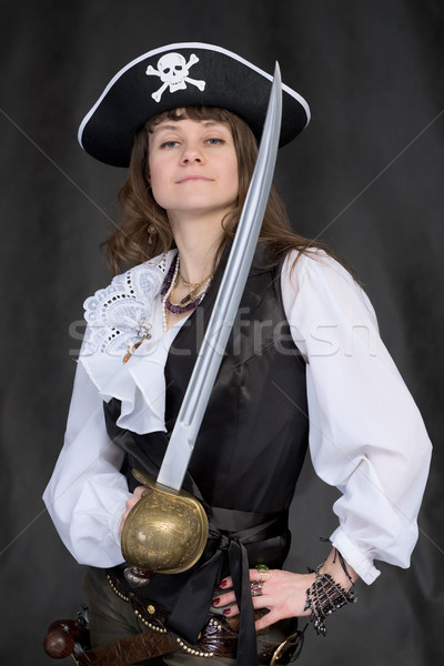 Stock photo: The girl - pirate with a sabre in hands