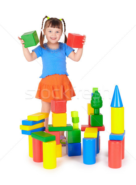 Little girl is playing with colored blocks Stock photo © pzaxe