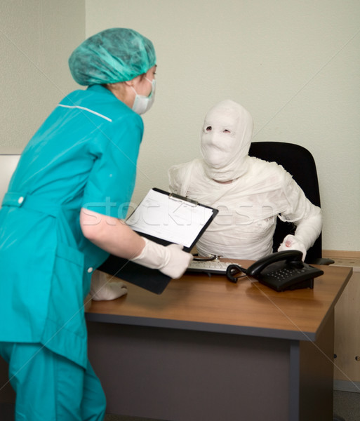 Patient similar to a mummy and the doctor Stock photo © pzaxe