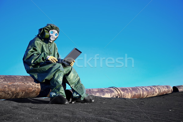 Scientist with a laptop on chemically contaminated area Stock photo © pzaxe