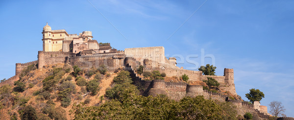 Domed tower and fortified wall of Kumbhalgarh Fortress near Udai Stock photo © pzaxe