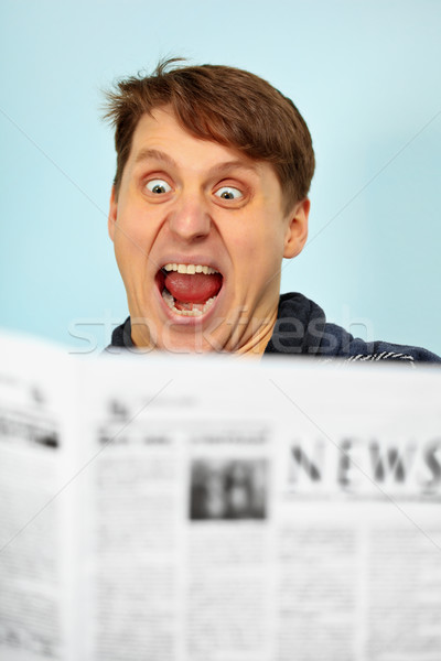 Man shocked - bad news from newspaper Stock photo © pzaxe