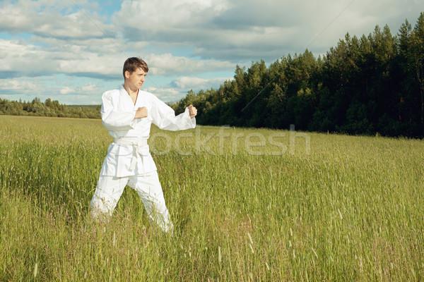 Man in kimono trains karate in open air Stock photo © pzaxe