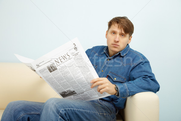 Man disappointed with news from newspaper Stock photo © pzaxe