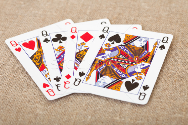 Four playing cards - queens on canvas Stock photo © pzaxe