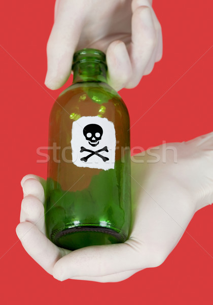 Green bottle with skull and crossbones Stock photo © pzaxe