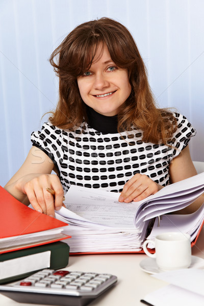 Woman is working with financial documents Stock photo © pzaxe