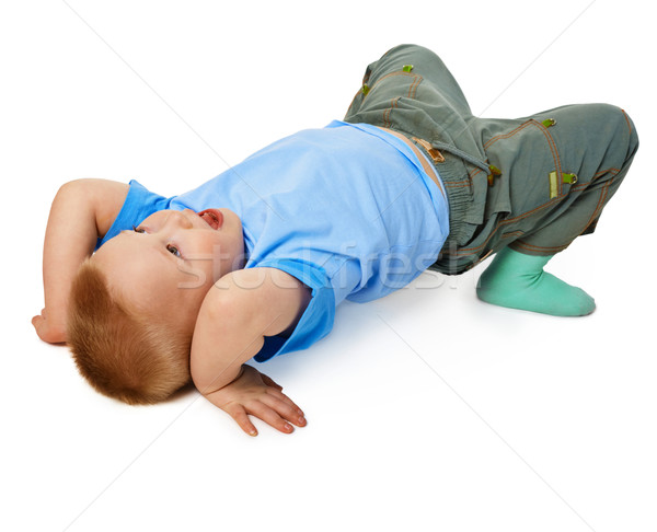 Child tries to do a gymnastic stance on floor Stock photo © pzaxe