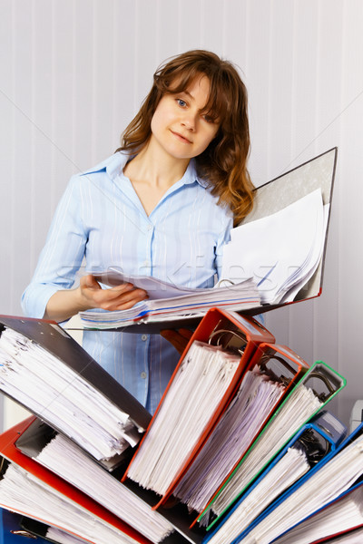 Female accountant and financial documentation Stock photo © pzaxe