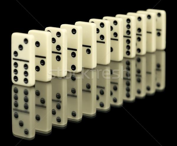 Bones of domino on black Stock photo © pzaxe