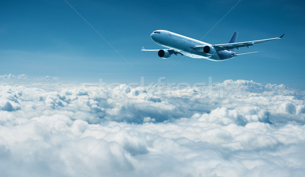 Airplane flies above clouds - air travel Stock photo © pzaxe