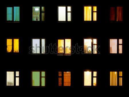 Night windows - block of flats background Stock photo © pzaxe