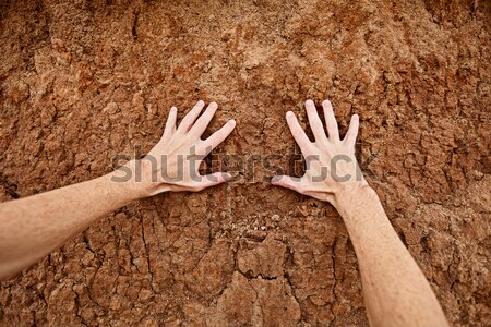 Hand with lumps of clay ground Stock photo © pzaxe