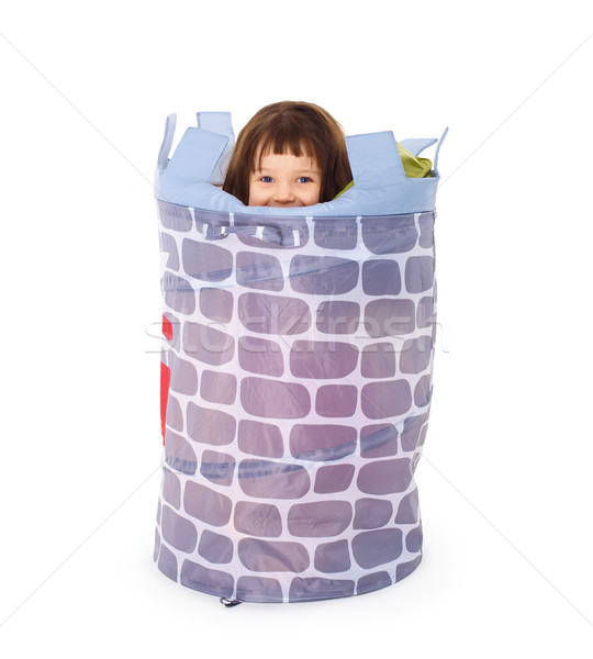 Little girl hides in toy basket Stock photo © pzaxe