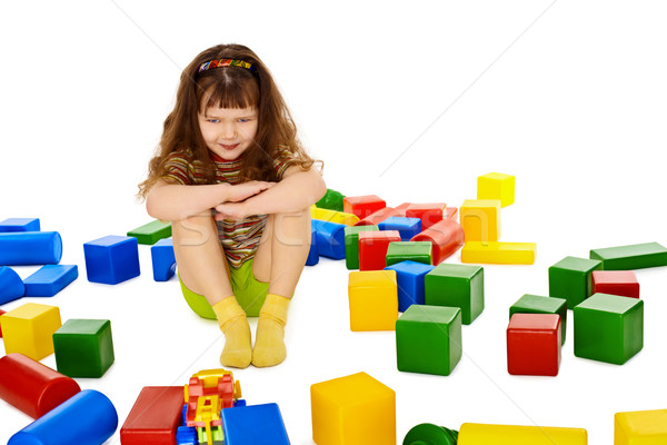 Angry little girl among the scattered toys Stock photo © pzaxe