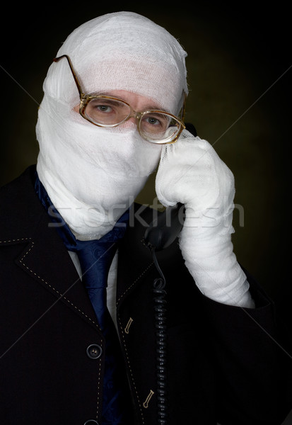 Man in bandage calling on phone Stock photo © pzaxe