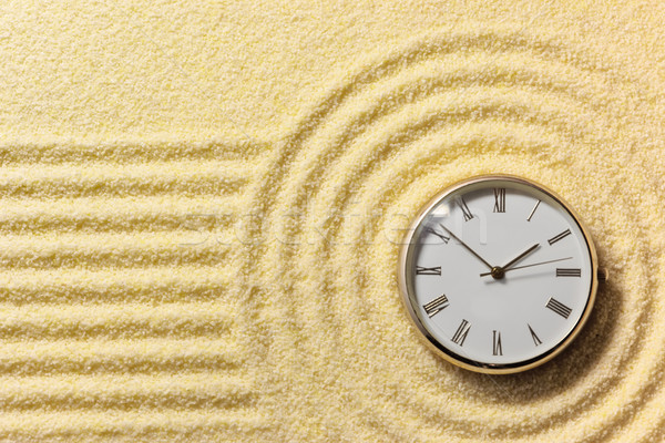 Old watch on surface of golden sand Stock photo © pzaxe