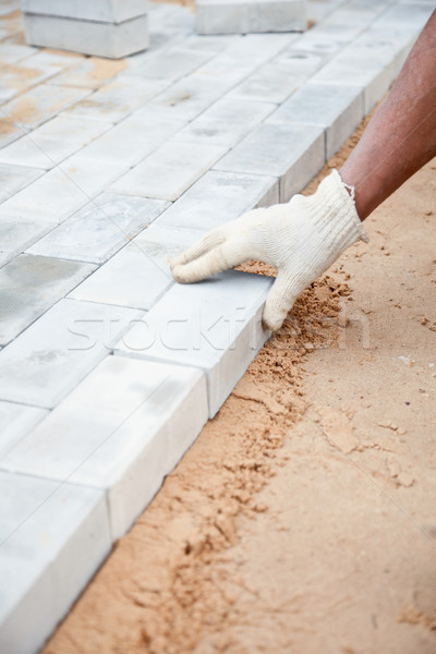Installation of brick platform - laying bricks on sand Stock photo © pzaxe