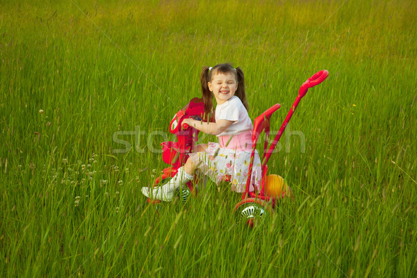 Comical child on a bicycle - grimace Stock photo © pzaxe