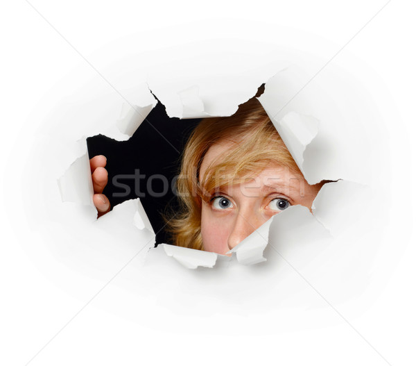 Face peeping out of hole - female curiosity Stock photo © pzaxe