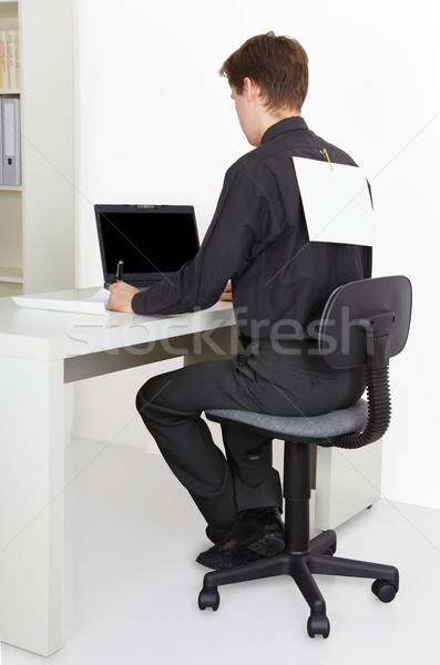 Man working in office, attach to back poster Stock photo © pzaxe