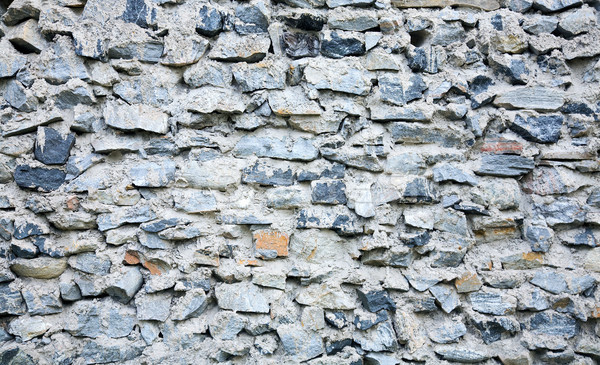 Ancient grunge rough stone wall Stock photo © pzaxe