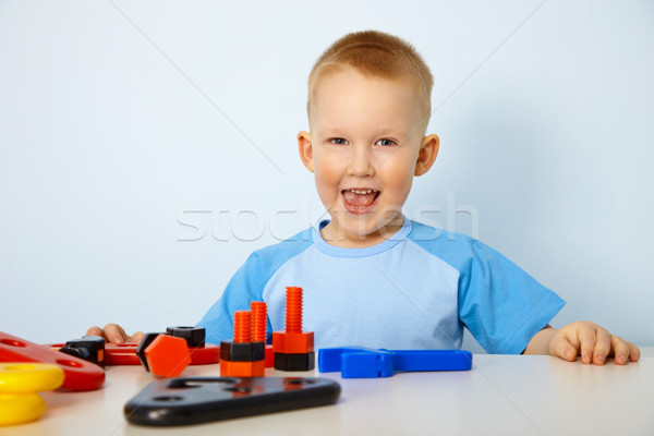 Happy little boy playing with toys Stock photo © pzaxe