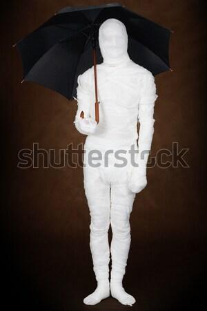 Mummy under umbrella Stock photo © pzaxe