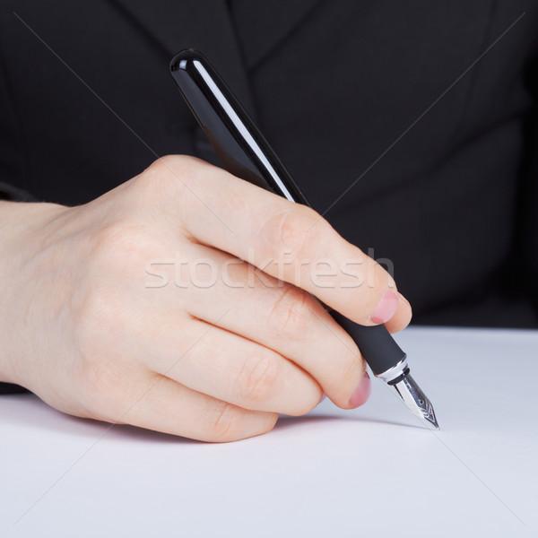 Női kéz tart töltőtoll ezüst toll Stock fotó © pzaxe