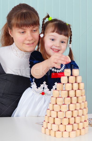 Mom and daughter play - to build a tower Stock photo © pzaxe