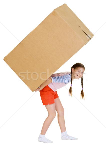 Stock photo: Girl bears the big heavy cardboard box