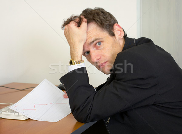 Sorrowful man at the office, on a workplace Stock photo © pzaxe