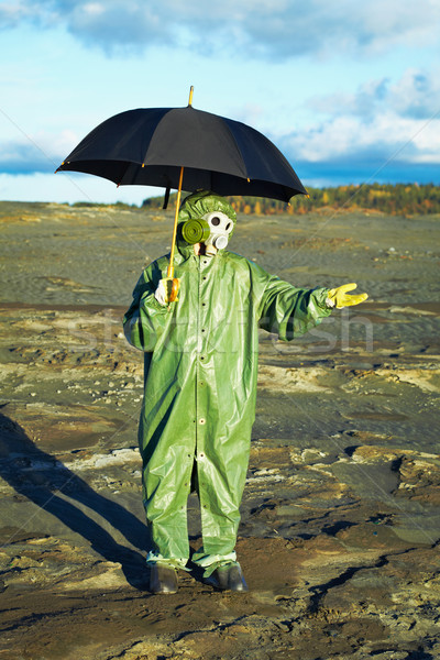 Man in gas mask with umbrella waiting for acid rain Stock photo © pzaxe