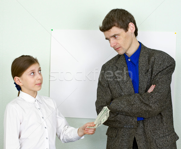 Girl stretches money to the guy Stock photo © pzaxe