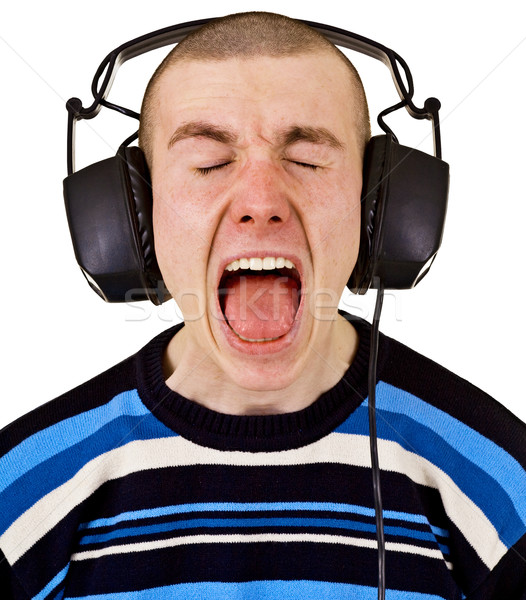 Stock photo: Shout male music lover with big headphones
