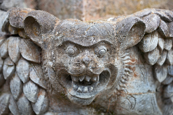 Muzzle fantastic beast on the wall of an old Indonesian temple Stock photo © pzaxe